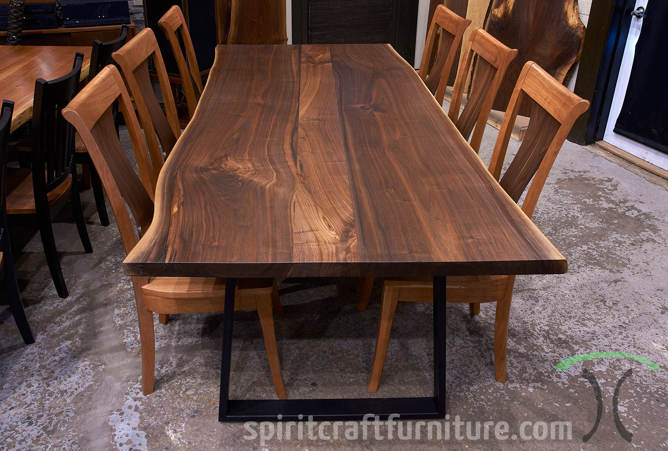 RH Yoder Benjamin Side Chairs in Cherry with Walnut Back Panel with Walnut Live Edge Dining Table Pictured in our Showroom