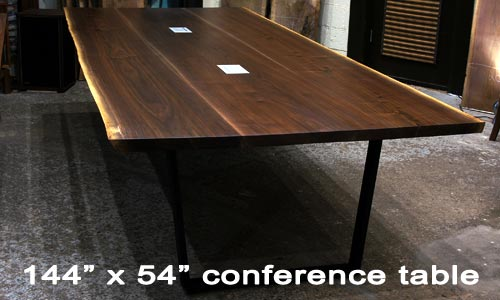 Custom made 144 x 54 black walnut conference table for br foods boardroom in chicago area