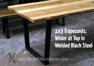 Custom made 1 x 3 steel trapezoid legs, painted black on live edge ash table top.