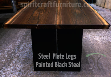 Custom made solid black walnut conference table with custom made steel plate legs for kendall jackson winery, california