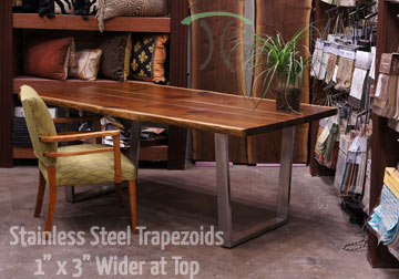 Custom made 1 x 3 steel brushed stainless steel trapezoid legs on live edge black walnut table top.
