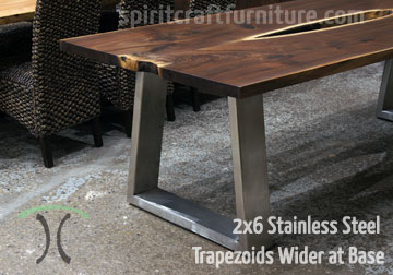 Custom made 2 x 6 brushed stainless steel trapezoid legs on live edge black walnut table top.
