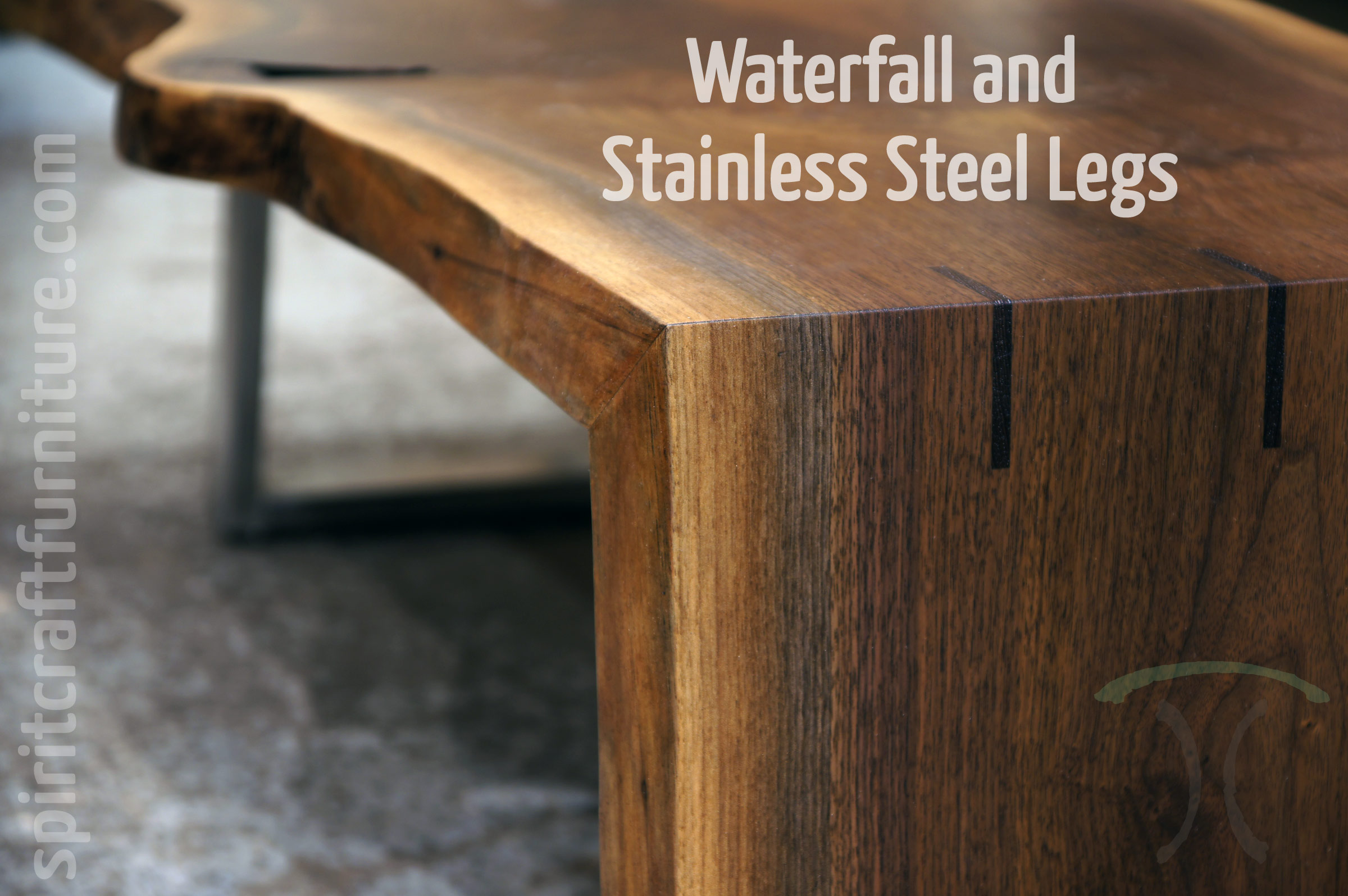 Solid Black Walnut live edge Waterfall Coffee Table with miter joint, walnut splines and one stainless steel leg.