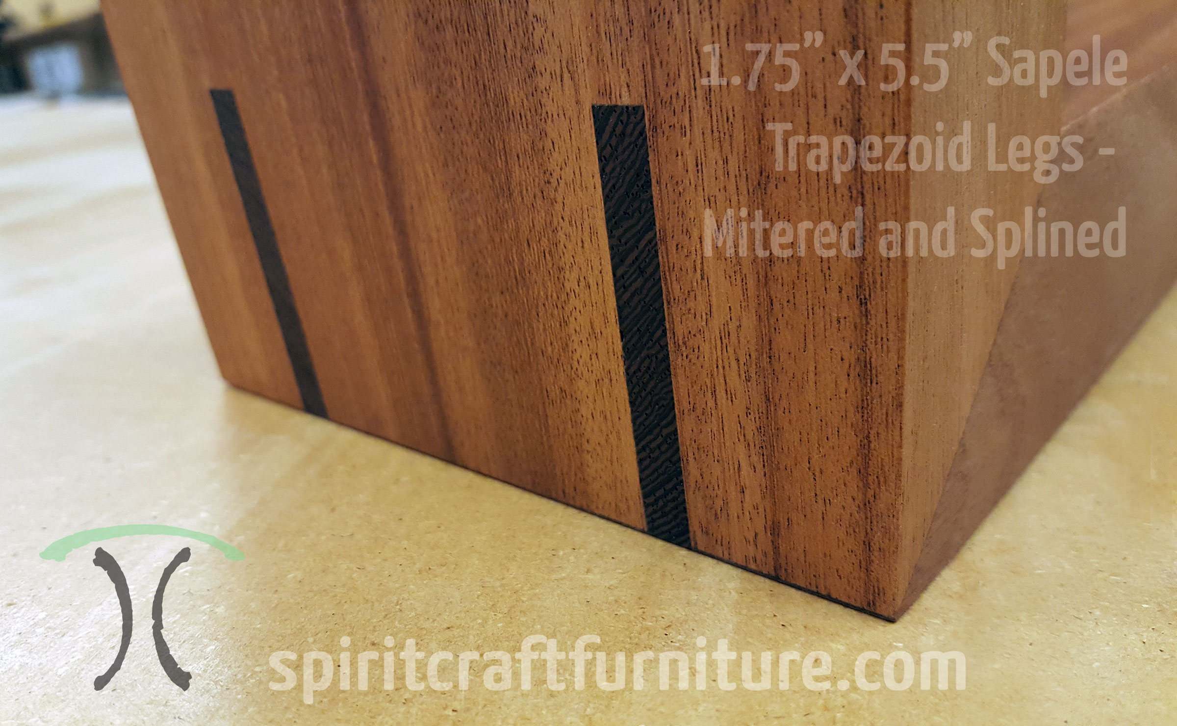 Detail of Sapele mitered and splined trapezoid legs with Wenge Splines