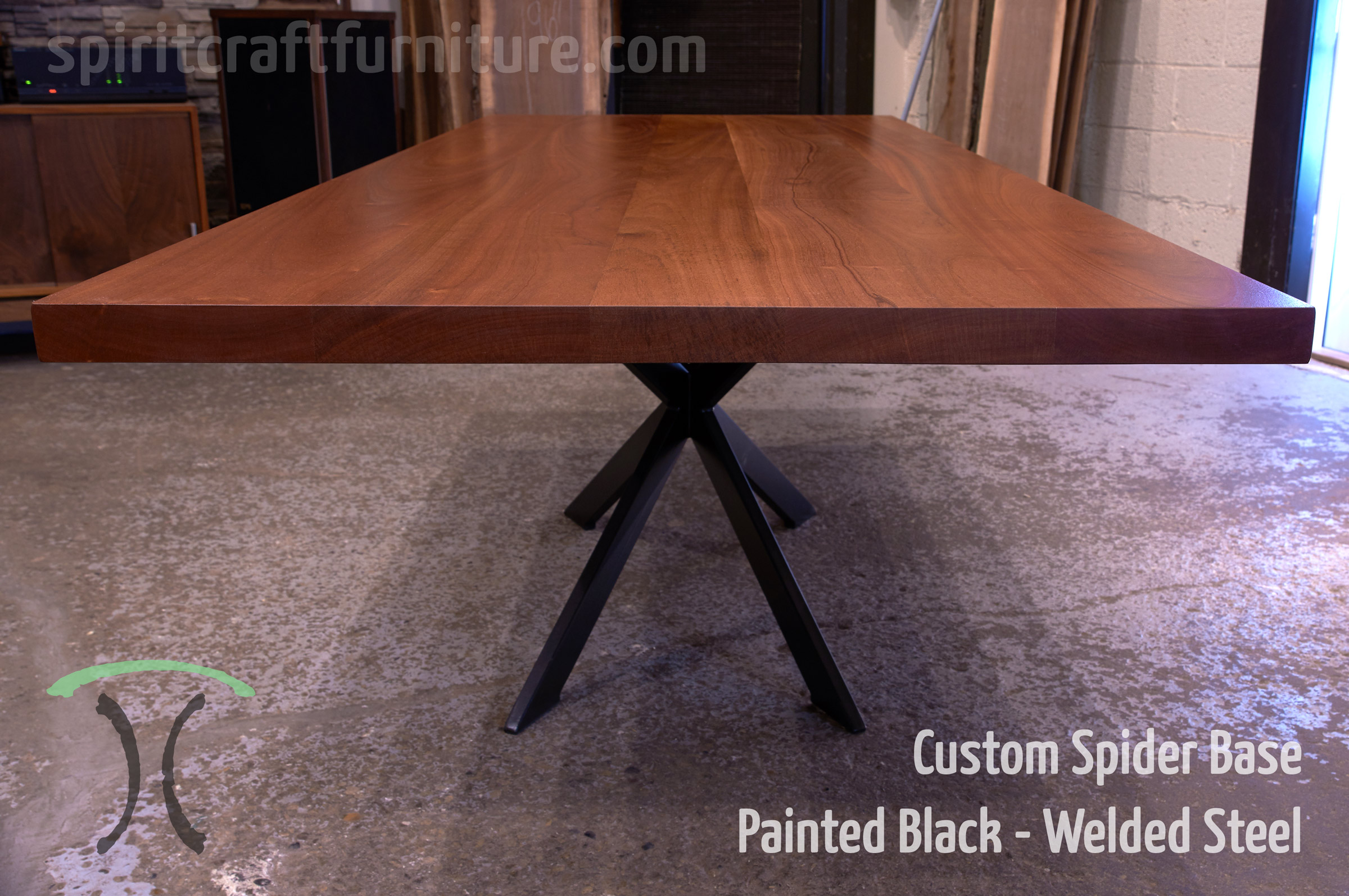 Custom made 1 x 3 profile spider table base, steel painted black with sapele slab table top.