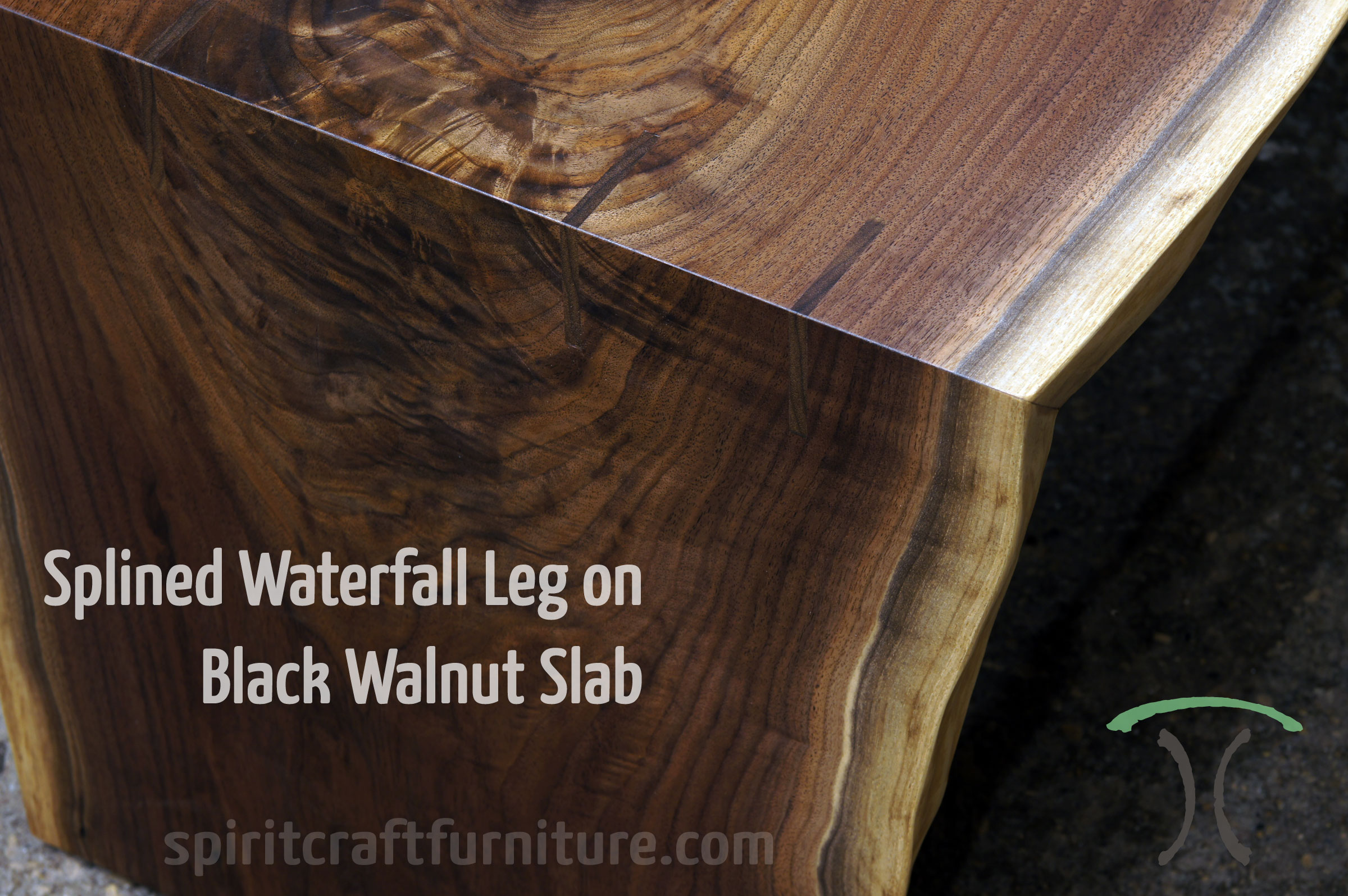 Solid Black Walnut live edge Waterfall Coffee Table with perfect miter joint and walnut splines.