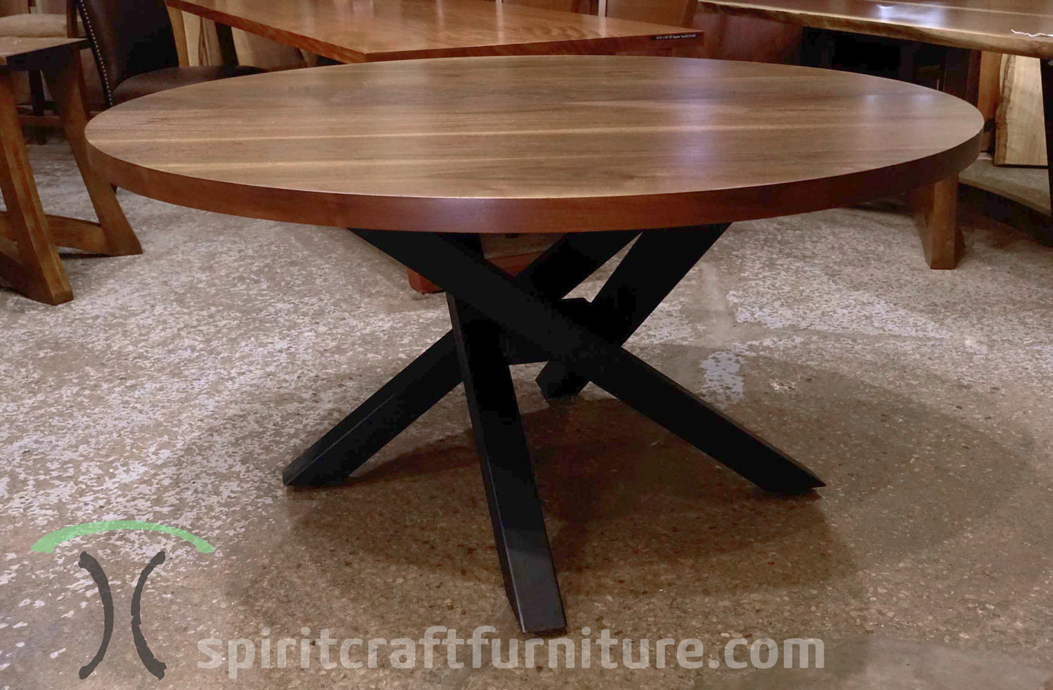 60 Inch Round Walnut dining table in Chicago area from Spiritcraft Furniture in East Dundee, IL.