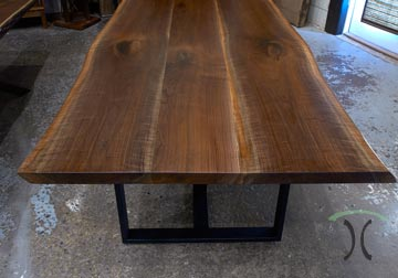 Live edge Walnut dining table with black steel tri legs