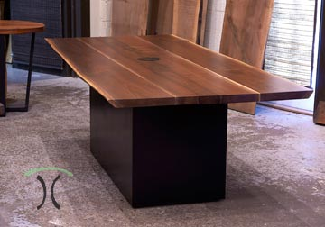 Live edge dining table and bench in solid book-matched Black Walnut live edge slabs on stainless steel and hardwood legs, on display at our in Chicago area live edge furniture showroom in East Dundee, Illinois