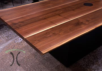 Solid hardwood live edge walnut conference table with power and data grommet with custom painted base for Chicao, Lombard client by Spiritcraft Design Furnitue in East Dundee, Illinois