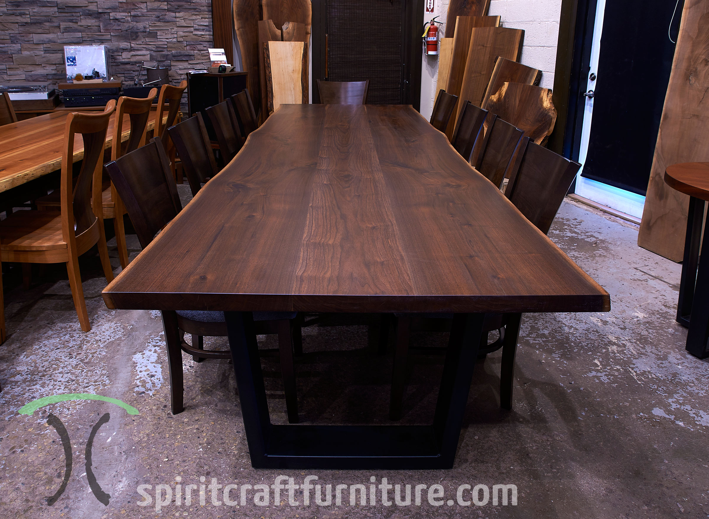 Black Walnut Live Edge conference room table for New York corporate boardroom with RH Yoder Somerset Chairs from Chicago area custom woodshop Spiritcraft Furniture of East Dundee, IL.
