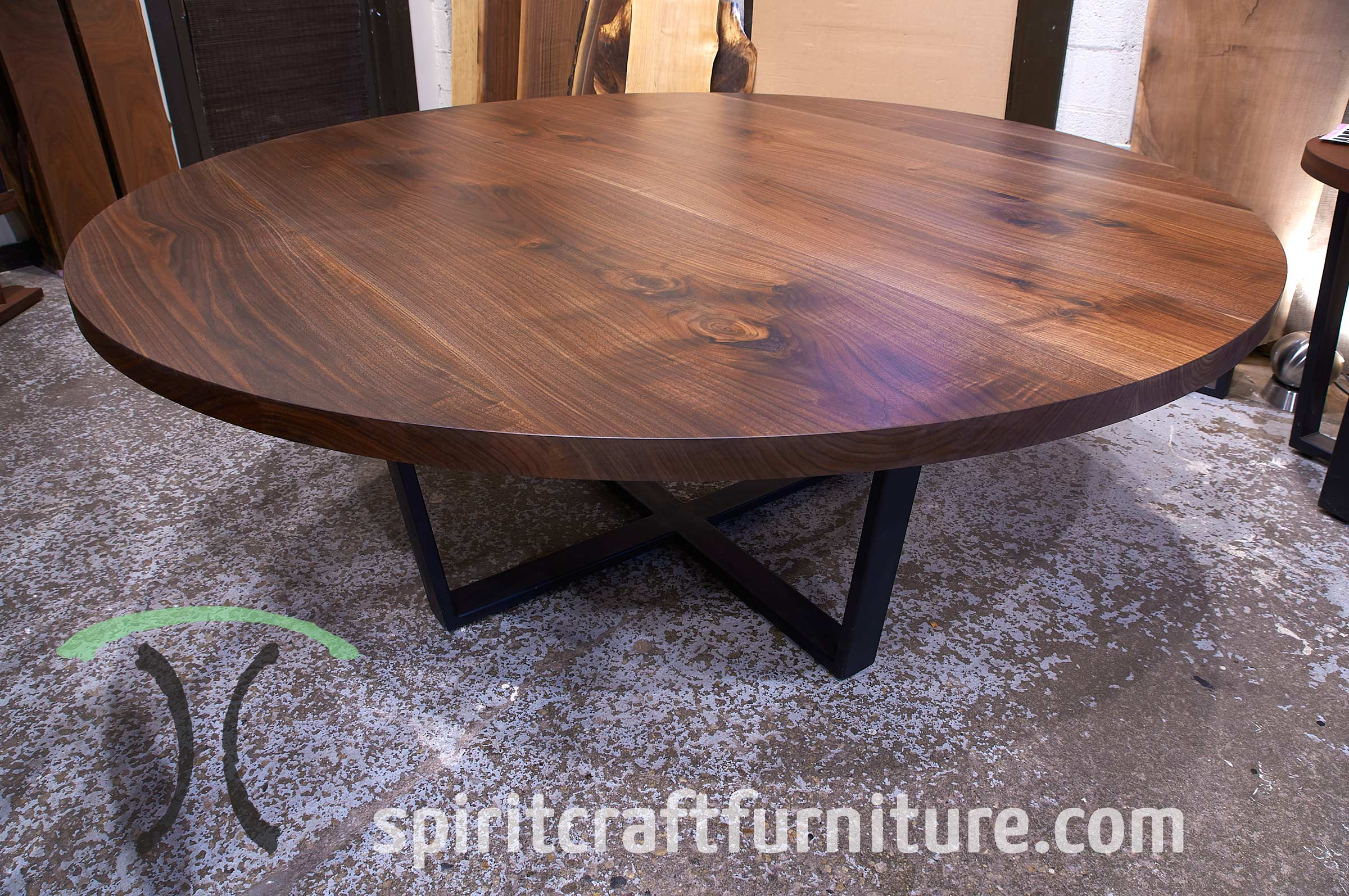 72 inch Black Walnut Round Conference Table on Crossed Trapezoidal Steel Base that will seat eight, handcrafted in Chicago area, Illinois.