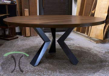 Custom made solid black walnut round dining top with custom made welded steel knee legs handcrafted for chicago client
