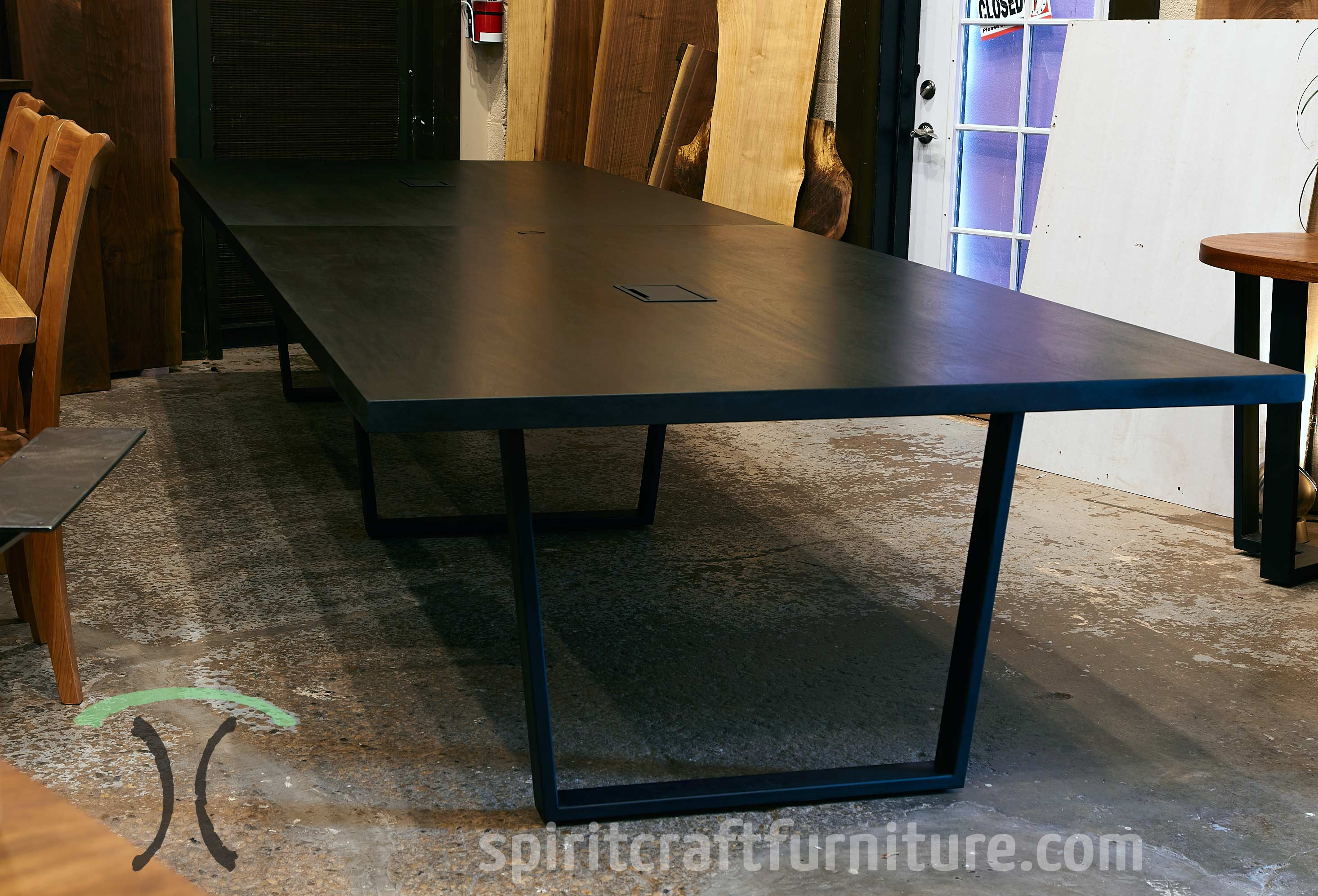 Massive 192 x 54 Sapele Mahogany Conference Table with Custom Legs and Mockett Grommets, Stained in Dark Walnut handcrafted at Spiritcraft Furniture in East Dundee, Illinois