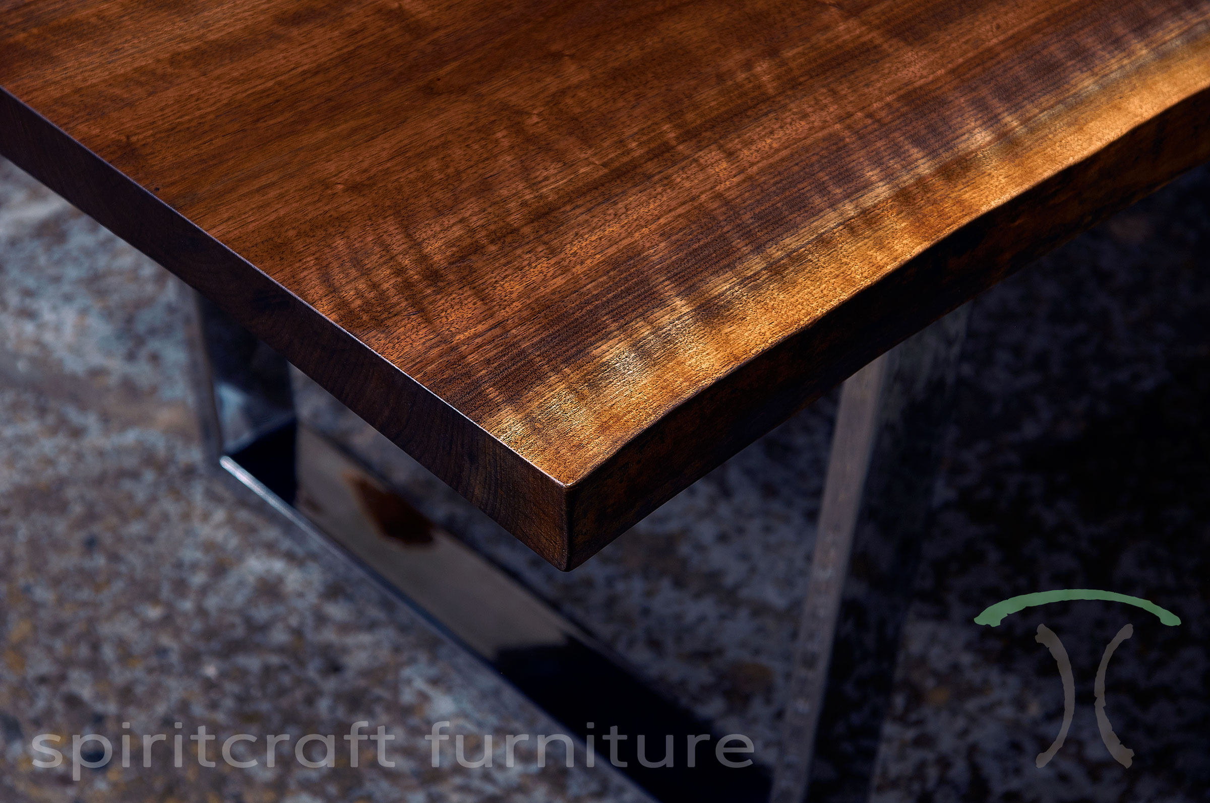 Solid hardwood live edge walnut conference table with polished stainless legs for Chicago client by Spiritcraft Design Furnitue in East Dundee, Illinois