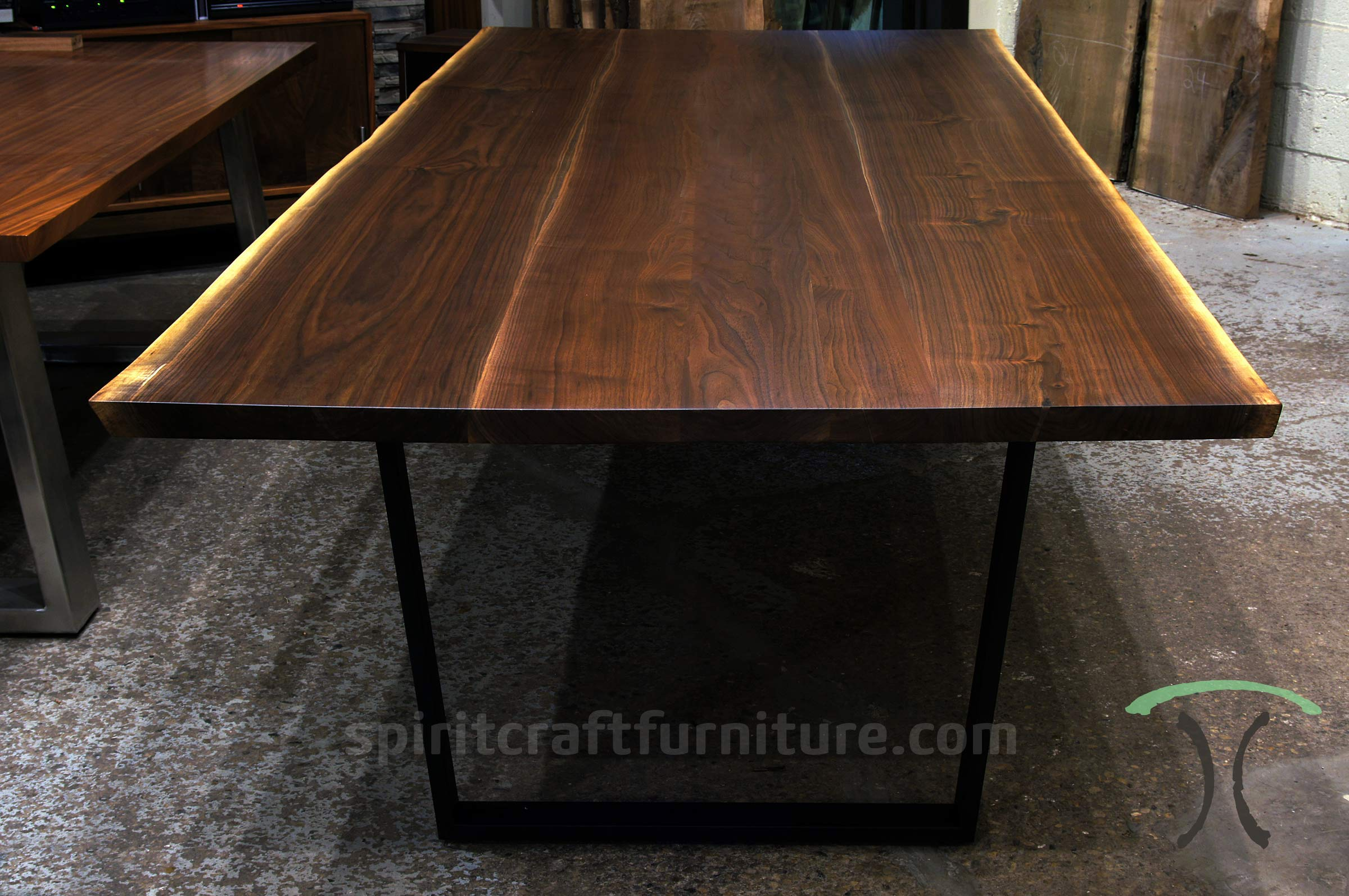 Live edge conference table handcrafted in Dundee, IL and shown in our furniture store in Chicago area, East Dundee, Illinois