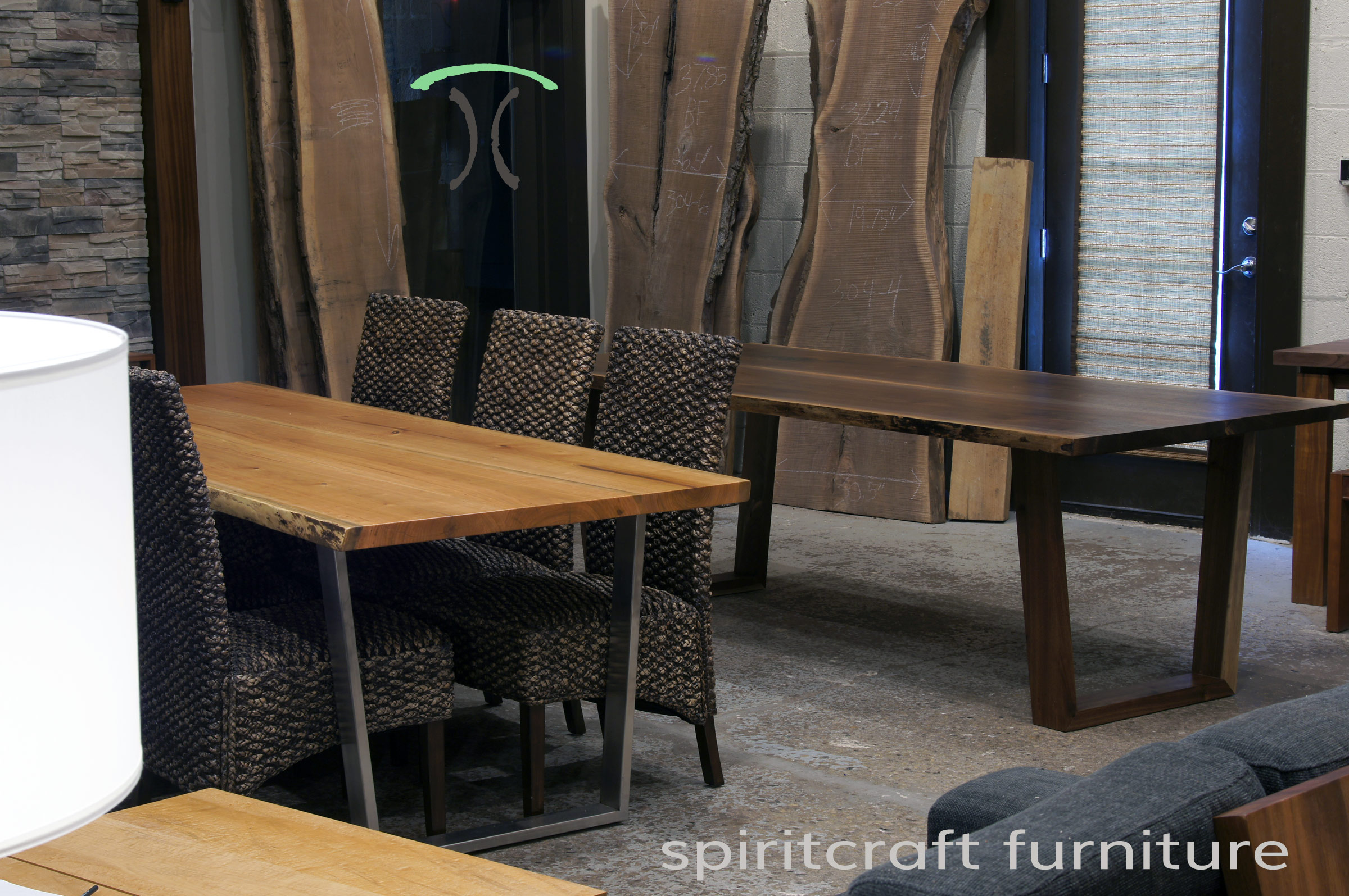 Live edge dining conference tables in solid book-matched Black Walnut and Cherry live edge slabs on Walnut and Stainless steel legs, on display at our retail furniture store in Chicago area, East Dundee, Illinois