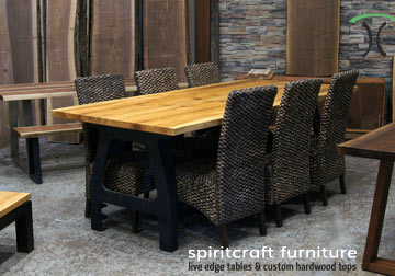 Natural edge dining and conference tables in Walnut and Sycamore with kiln dried slabs on hardwood and cast iron legs, on display at our live edge edge furniture store in Chicago area, East Dundee, Illinois