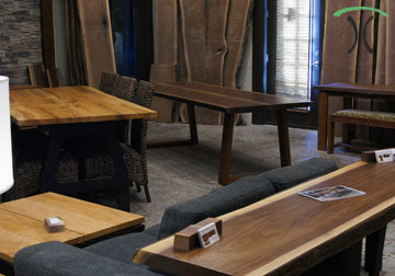 Live edge dining and conference tables in Walnut and Sycamore from kiln dried slabs on hardwood and cast iron legs, on display at our living edge edge furniture store in Chicago area, East Dundee, Illinois