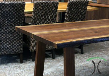 Live edge dining and conference tables in solid Black Walnut and Sycamore with live edge kiln dried slabs on hardwood and cast iron legs, on display at our living edge furniture store in Chicago area, East Dundee, Illinois