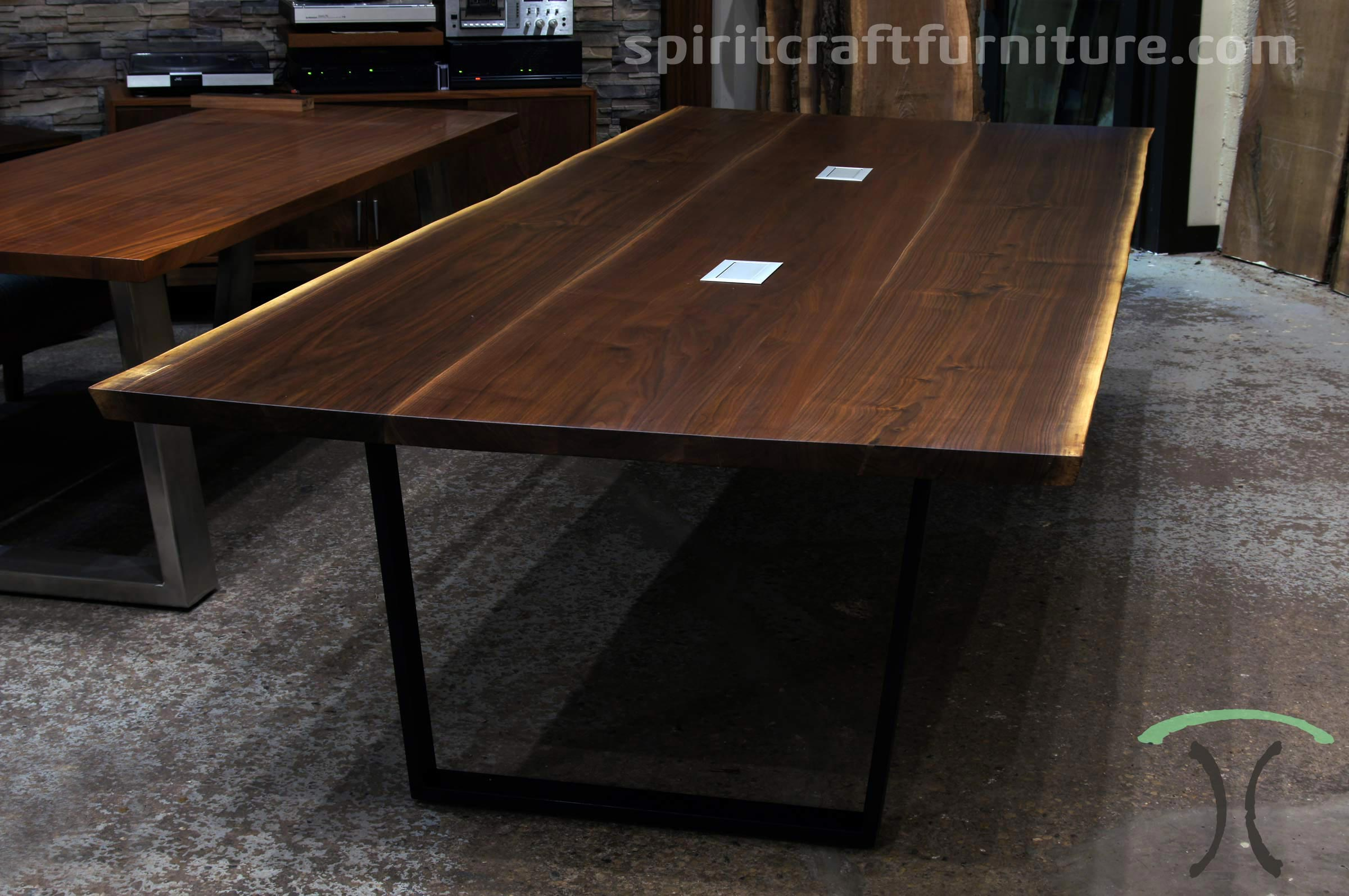 Large live edge conference in solid Black Walnut slabs on steel trapezoid legs at our conference and dining table showroom and store in the Chicago area, East Dundee, Illinois