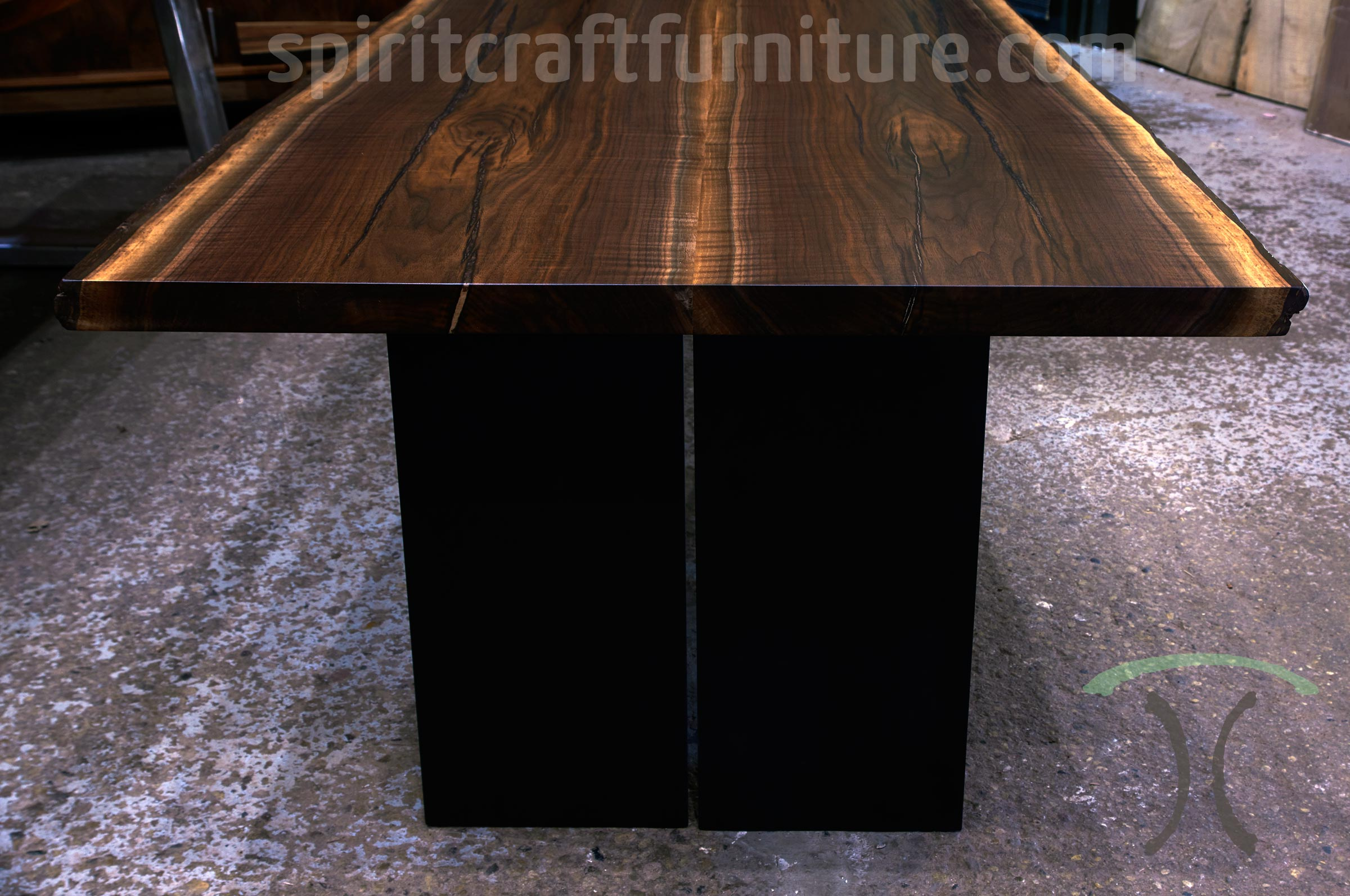 Live edge conference table in sustainable rescued Black Walnut table top on plate steel slab legs for Santa Rosa, CA corporate office, tables are custom made at our Chicago area showroom and furniture shop in Dundee, IL.