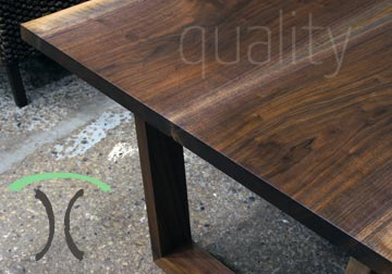 Black Walnut Live Edge Conference Table on Wooden Trapezoid Legs from our Chicago Area Furniture Store, Handcrafted, Heirloom Quality.
