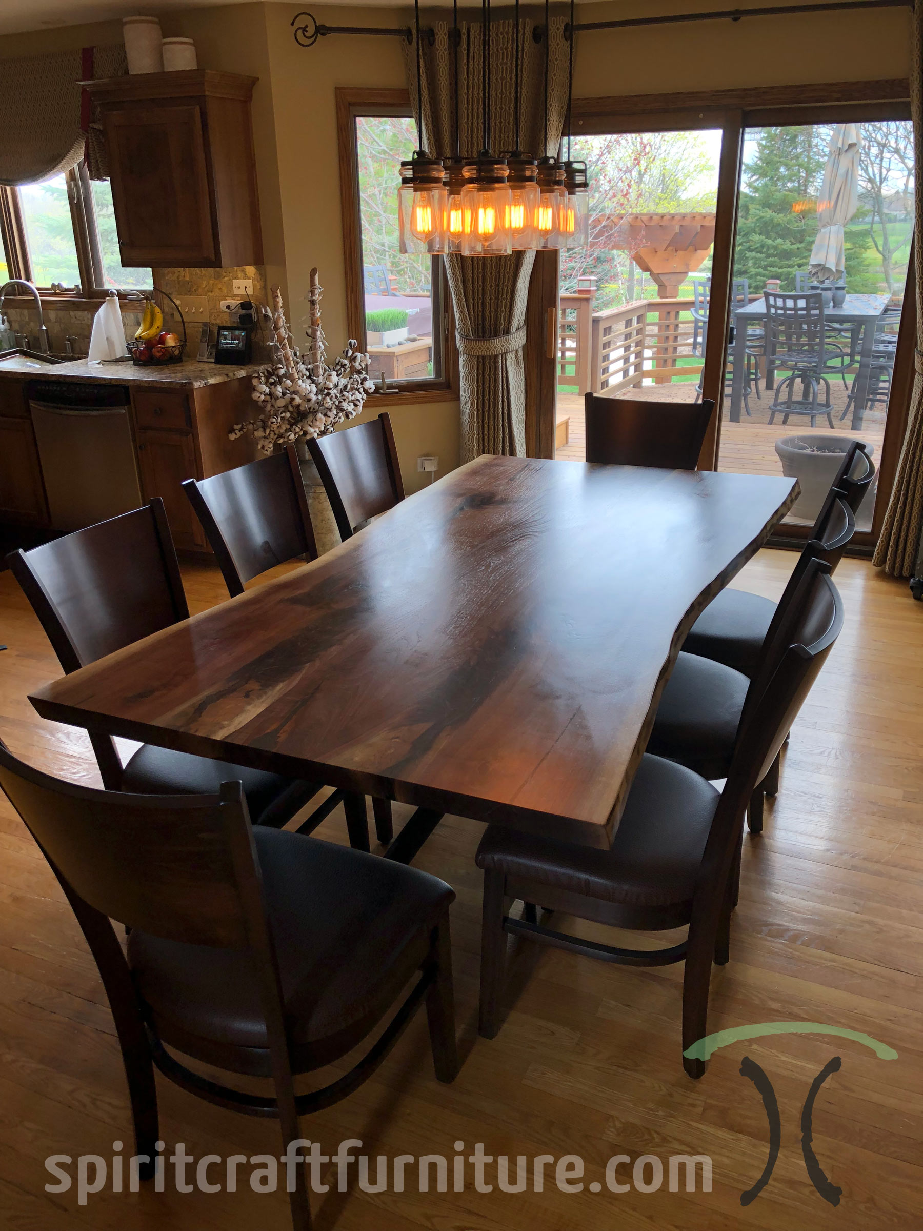Solid hardwood live edge dining table from slabs of kiln dried Black Walnut with RH Yoder chairs at Spiritcraft Design Furniture in East Dundee, Illinois