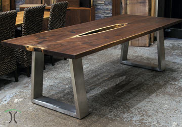 Live edge Walnut dining table with our original modern and substantial industrial style trapezoid Stainless Steel legs, book-matched slabs from solid kiln dried rescued Black Walnut for Chicago client.