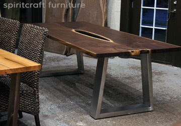 Black Walnut live edge dining conference table with Stainless Steel trapezoid style legs for Chicago area, Long Grove, Illinois client. Available at Spiritcraft Furniture, Dundee, IL