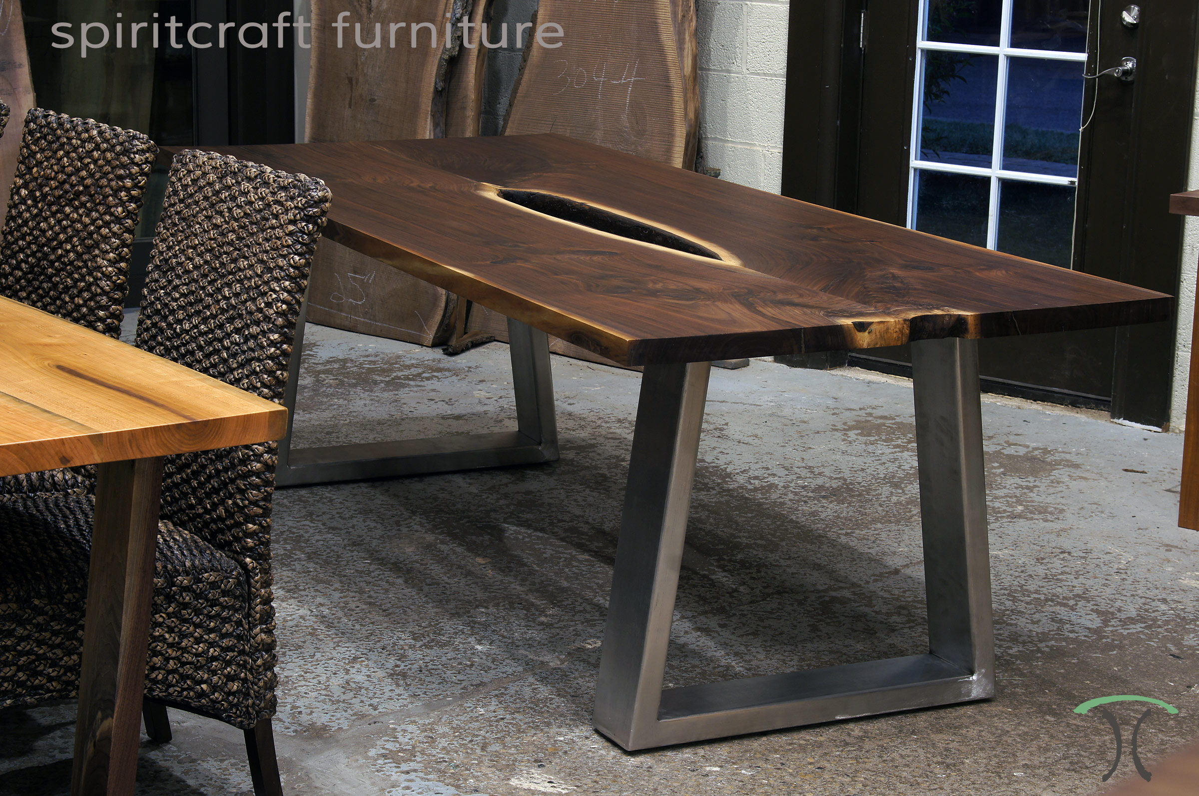 Black Walnut live edge dining conference table with Stainless Steel trapezoid style legs for Chicago area,Long Grove, Illinois client. Available at Spiritcraft Furniture, Dundee, IL