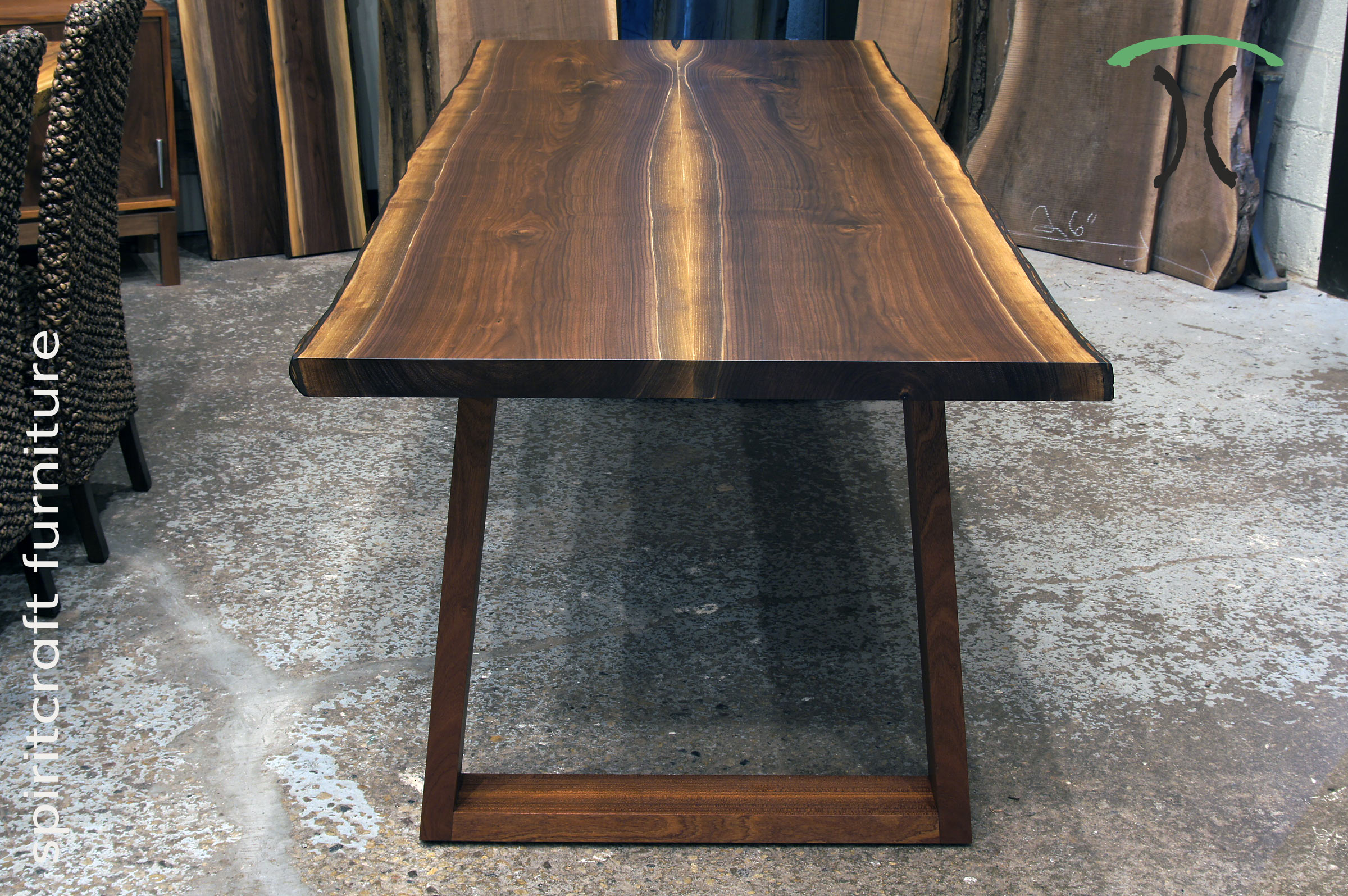 Living edge dining and conference tables in solid Black Walnut from kiln dried slabs on display at our live edge furniture store in Chicago area, East Dundee, Illinois