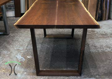 Black Walnut Live Edge Dining Table on Hardwood Trapezoids by spiritcraft interior design furniture in east dundee, illinois