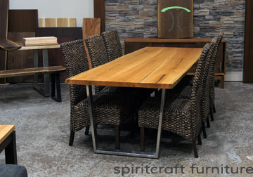 Live edge Dining or Conference Table in solid Cherry on stainless steel trapezoid legs at our living edge furniture store in Chicago area, East Dundee, Illinois