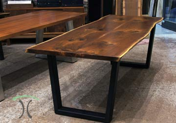 Live edge Walnut dining table from rescued and kiln dried hardwood on steel legs