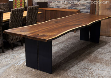 Live edge Chicago area Walnut dining table with steel legs.  Features book-matched Black Walnut slabs from solid kiln dried Black Walnut
