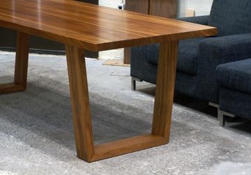 Mid Century Modern influenced solid slab dining table in Sapele Mahogany with trapezoid legs by Spiritcraft Design Funriture of East Dundee, IL.