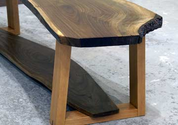 Black Walnut live edge slab bench with inverted Mod Century trapezoid solid hardwood legs and lower slab shelf