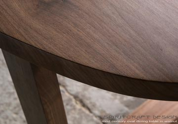 Black Walnut slab oval table top on our mitered and splined open legs for New York client by spiritcraft design furniture in east dundee, il