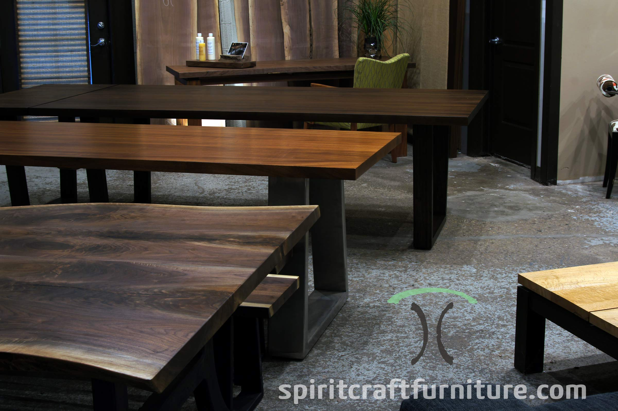 Heirloom quality dining and conference tables on wooden, stainless and steel legs in Sapele Mahogany, Black Walnut and Cherry at our Chicago area furniture Company in East Dundee, IL.