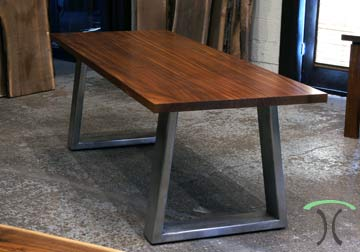 Sapele Mahogany slab conference table, desk on massive stainless steel mid century modern trapezoid legs for Chicago Client from Spiritcraft Furniture, East Dundee, IL..