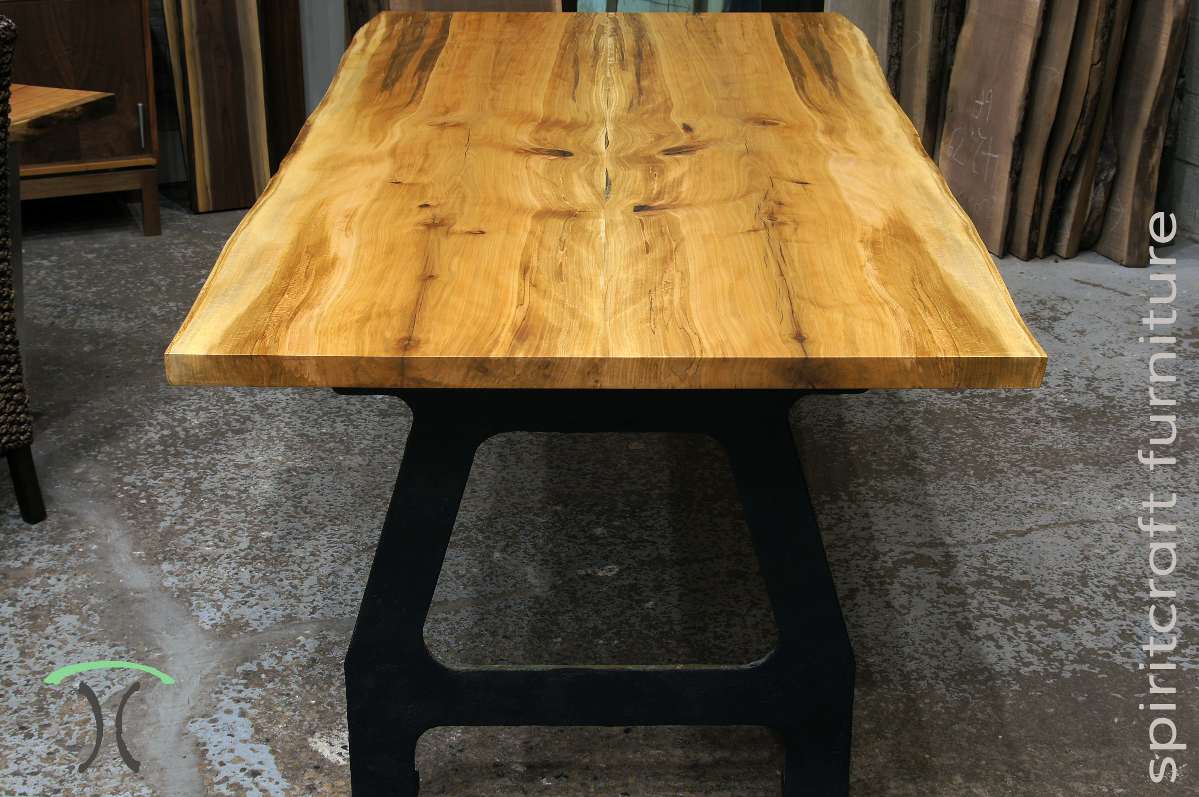 Live edge Dining or Conference Table in spalted Sycamore on industrial cast iron legs at our living edge furniture store in Chicago area, East Dundee, Illinois