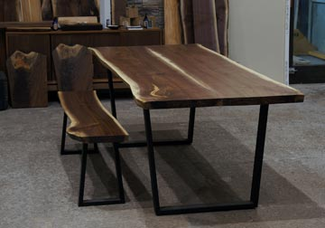 Black Walnut live edge dining table and Bench on steel trapezoid legs at Great Spirit Furniture Company, East Dundee, IL.
