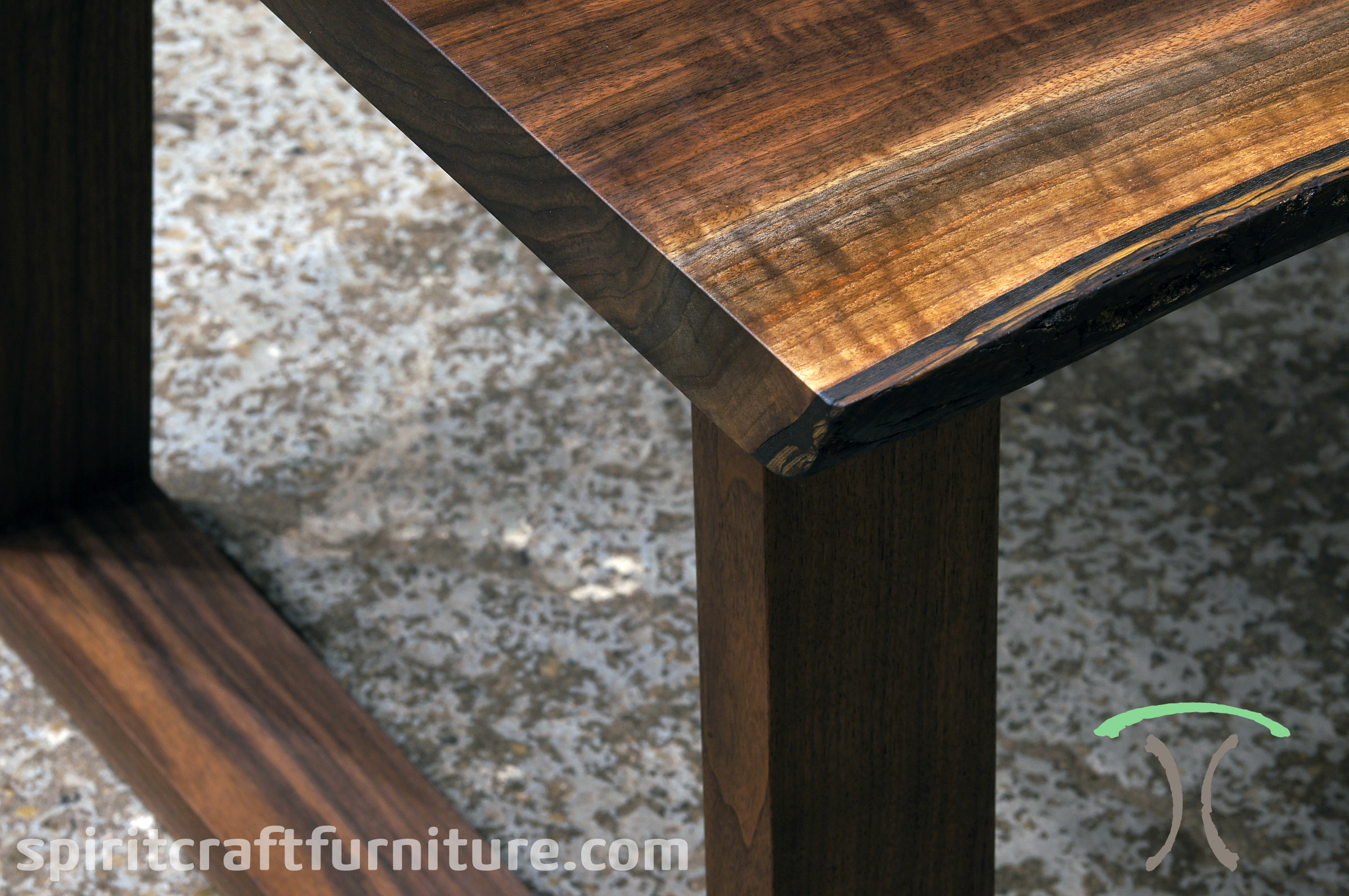 Kiln Dried Black Walnut live edge dining table with our solid hardwood trapezoid legs at Chicago area Living Edge Furniture Company, East Dundee, IL.