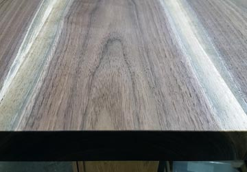 Black Walnut live edge slabs, after sanding with first finish seal coat applied.