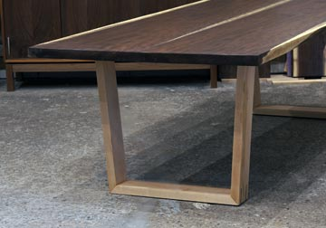 Live edge Walnut dining table with our original trapezoid Mid Century Modern style Maple legs, figured book-matched slabs from solid kiln dried rescued Black Walnut for Chicago client.