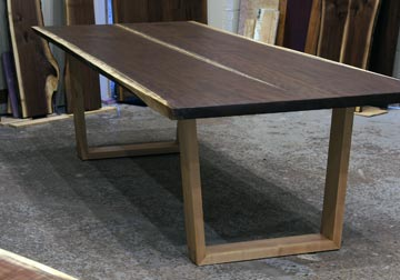 Black Walnut live edge dining table with mitered trapezoid style Hard Maple legs for Chicago area,Long Grove, Illinois client. Available at Great Spirit Furniture Company, Dundee, IL