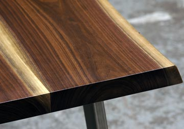 stunning live edge walnut kitchen table or desk with bruched stainless legs.