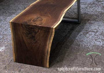 Black Walnut live edge coffee table with waterfall and stainless legs for Chicago area interior designer.
