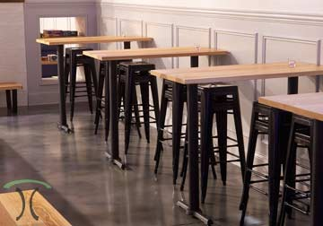 Custom Made Solid Hardwood Restaurant Dining Tables and Tops in White Ash on steel bases.